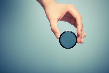 Hand holding polariser filter