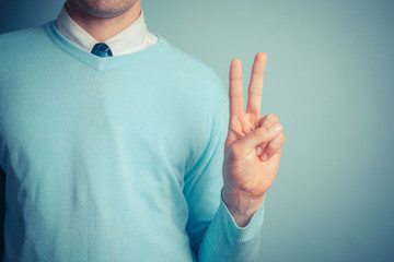 Man giving peace sign