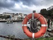Life buoy at the seaport in Tapia de Casariego, Spain