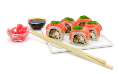 sushi on a plate with salmon, soy sauce and pickled ginger on a