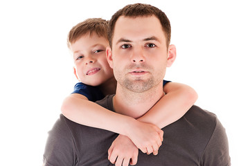 portrait young father with his son on back