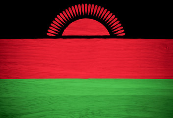 Malawi flag on wood texture
