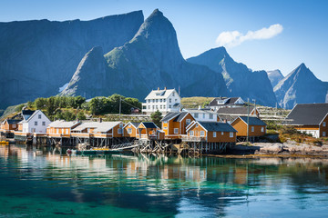 Typical Norwegian fishing village with traditional red rorbu hut