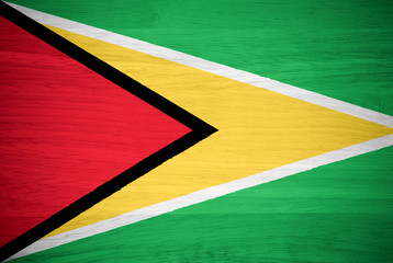 Guyana flag on wood texture