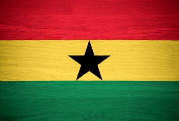 Ghana flag on wood texture
