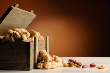 group of peanuts on a table with trunk wooden container