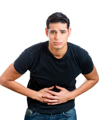 Young man having stomach upset, pain, holding belly