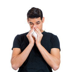 Sneezing man, having cold, runny nose, allergy to dust
