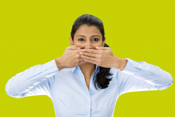 Speak no evil concept. Woman isolated on green background