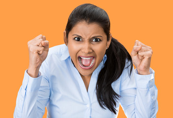 Portrait upset pissed off woman, screaming orange background