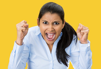 Portrait upset pissed off woman, screaming, yellow background