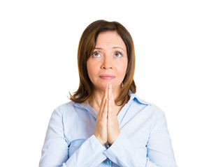 Portrait hopeful middle aged woman praying, asking for help