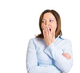 Portrait fatigued, sleepy yawning business woman