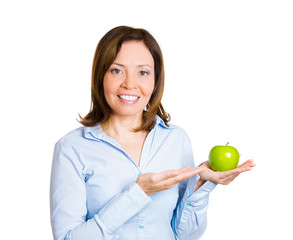 Portrait happy, smiling female nutritionist with green apple