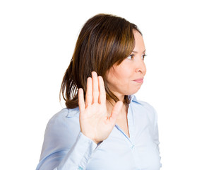 talk to my hand gesture of displeased middle aged woman