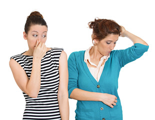 Is it you that stinks? woman looking at female covering nose