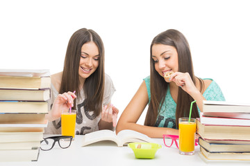Teenage girls eating while learning together