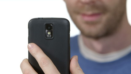 Man takes photo using cellphone