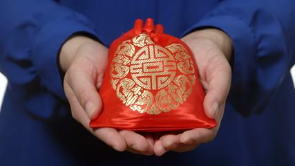 Asian woman presents Asian gift
