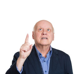 Man pointing finger upwards looking up, white background