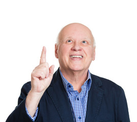 Idea! Senior man pointing finger up looking up, white background