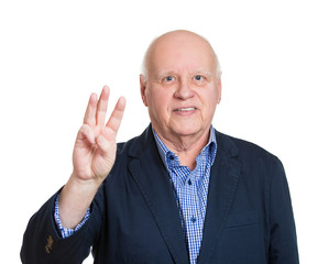 Senior man showing number three hand gesture, white background