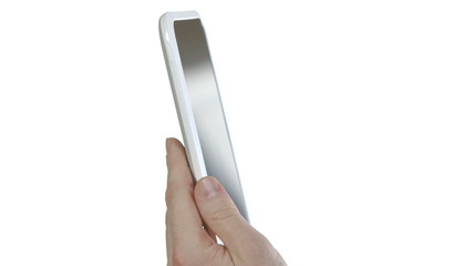A hand holds and swipes an ebook tablet.