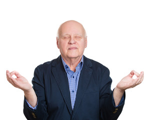 Senior man in zen mode, meditating on white background