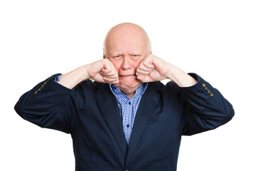 Portrait crying senior man isolated on white background