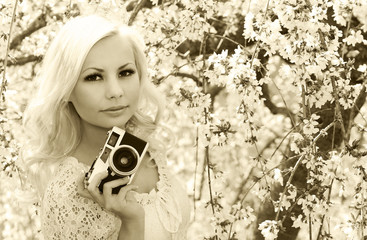 Photographer. Blonde Woman with Retro Camera