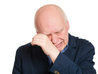Headshot crying senior, lonely man on white background