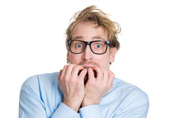 Anxious man biting finger nails, has panic attack