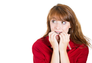 Anxiety. Headshot insecure young woman biting fingernails