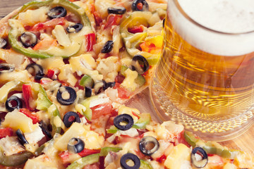 pizza on the table with a glass of beer