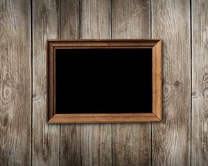 Vintage wooden frame on wood background