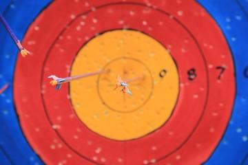 Three Arrow hit goal ring in archery target