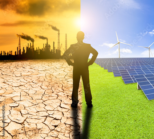 pollution and clean energy concept. businessman watching windmil