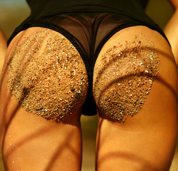 Sexy perfect sandy woman buttocks on tropical beach sea