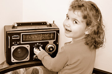 Sweet young girl and retro dusty radio