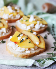 Homemade bruschetta with toasted wheat bread, ripe nectarines