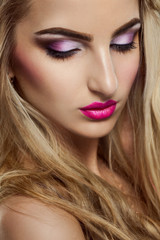 Pretty blonde woman with closed eyes