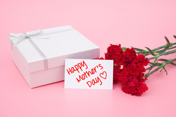 card of happy mother's day  and prensent box and red carnations