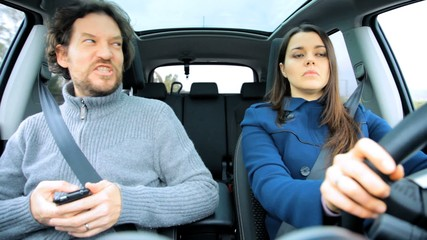 Woman jealous of husband texting fight in car