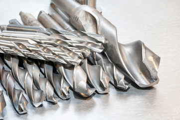 Metal drill bits. Drilling and milling industry. Closeup.