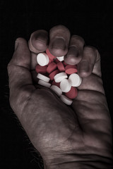 Holding Colored Pills