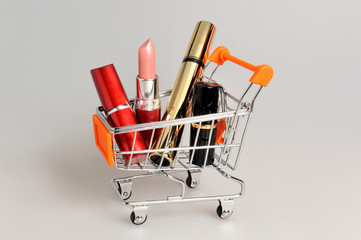 Makeup in pushcart on gray