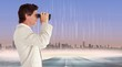 Composite image of businessman using binoculars