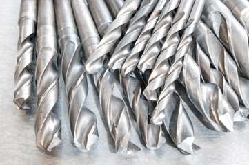 Metal drill bits. Drilling and milling industry. Closeup