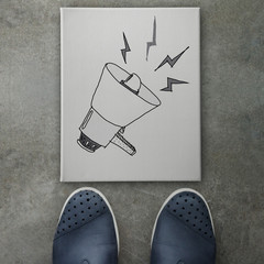 Hand drawn loudspeaker design doodle icon on front of business m