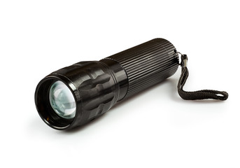 Metal flashlight. Isolated on white background